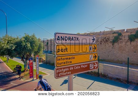 PALMA DE MALLORCA, SPAIN - AUGUST 18 2017: Informative sign with some people biking and walking around of the city of Palma de Mallorca in a beautiful blue sunny day in Palma de Mallorca, Spain.