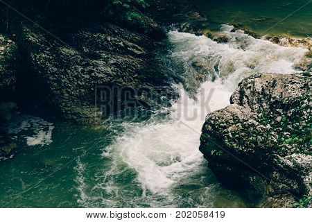 rocks cascade creek, mountain river, close up