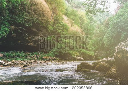 Nature landscape, tropical rain forest, river, water steam in Guam or Guamskoe gorge among the mountains in Krasnodar region, Russia