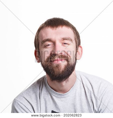 Pleasant news. Cheerful man smiling on white isolated background, studio shot, copy space