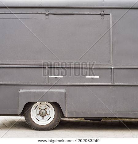 Part of retro food truck with closed doors