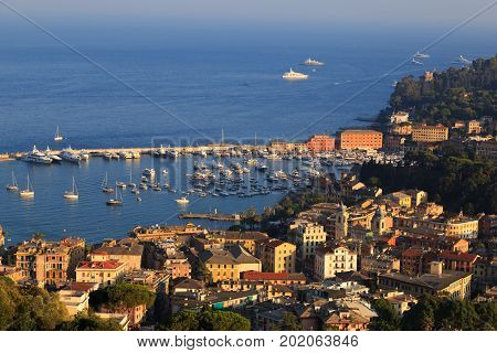 City of Santa Margherita Ligure Resort. Italy. Italian Riviera. Europe. Top view of the old city seaport with ships yachts and the sea. Concept of beach rest and relaxation. Tourism destination