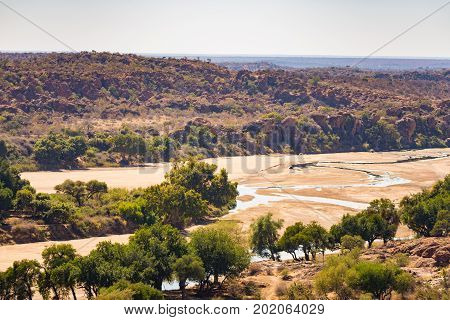 River Crossing The Desert Landscape Of Mapungubwe National Park, Travel Destination In South Africa.