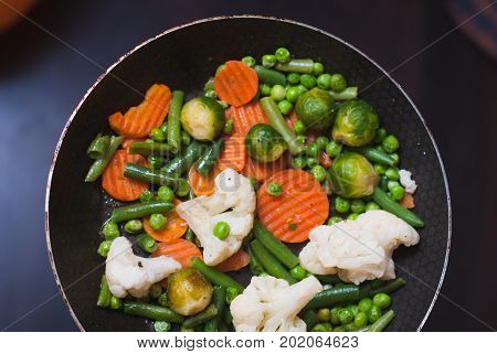 Roasted Vegetables In A Frying Pan, A Vegetable Stew On Top,