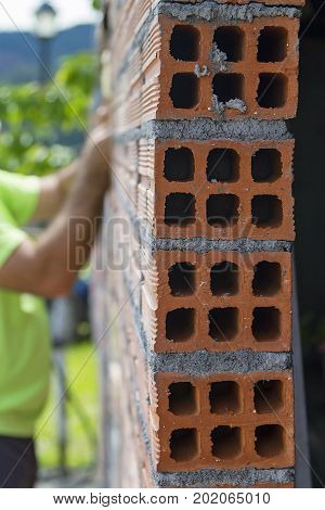 A man working in the construction of a wall