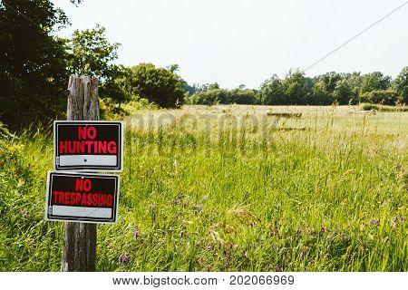 No Hunting And No Trespassing Signs At The Meadow In The Countryside Ontario, Canada
