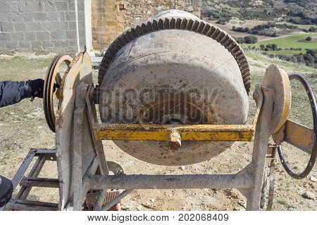 A concrete mixer machine used in construction works