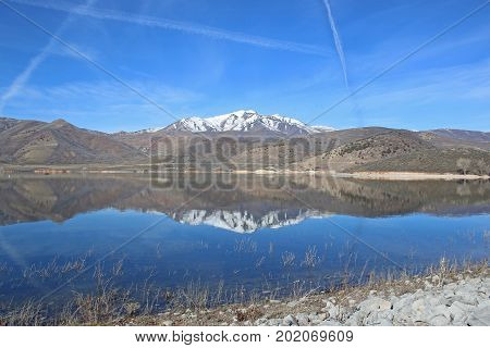 Mountains reflected in Deer Creek Reservoir in Utah