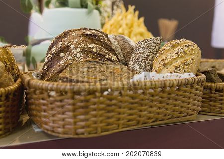 Freshly backed breads in basket at supermarket, close up view