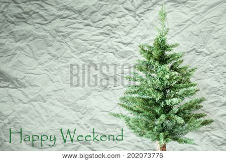 Crumpled Paper Background WIth English Text Happy Weekend. Christmas Tree Or Fir Tree In Front Of Textured Background.