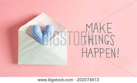 Make Things Happen message with a blue heart cushion in an envelope