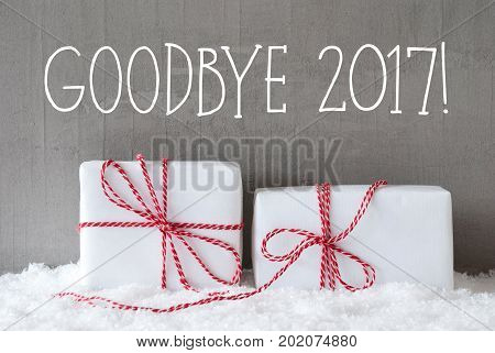 English Text Goodbye 2017 For Happy New Year. Two White Christmas Gifts Or Presents On Snow. Cement Wall As Background. Modern And Urban Style. Card For Birthday Or Seasons Greetings.