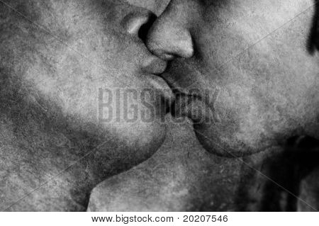 monochrome image of an anonymous african-american couple kissing
