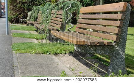Series of benches located along a footpath