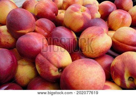 Stack of Peaches for sale on a market stall