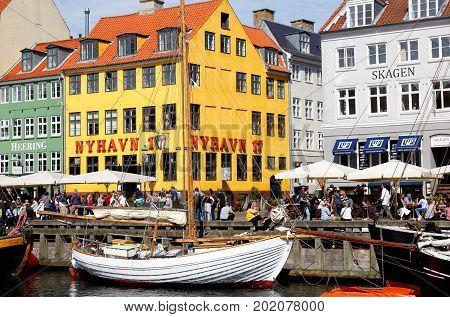 Copenhagen Denmark - August 24 2017: Exterior view of the yellew building withh the restaurant Nyhavn 17 in Nyhavn.