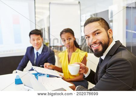 Interracial business people in team meeting in start-up company