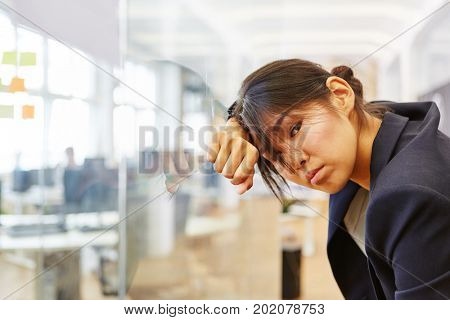 Asian woman as exhausted businesswoman with Burnout