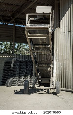 Old conveyor cement loader for a truck
