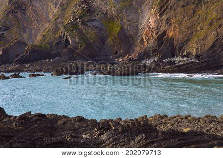 Coast of the sea with stone beds. Hartland Quay. Not far from the Hartland Point. Devon. England