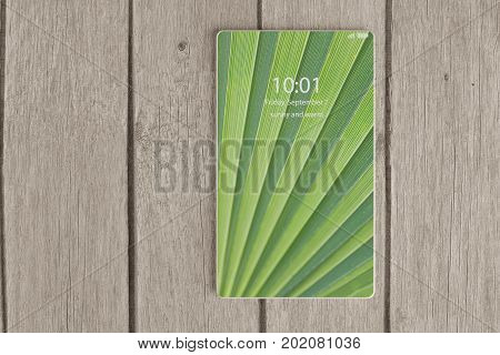 3D illustration of next generation bezel-free smartphone lying flat on wooden table.