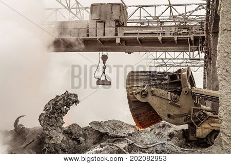Waste management metallurgical industry. Unloading of hot slag by truck transporter to slag dump.