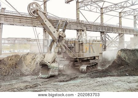 Mining excavator in the industrial outdoors plant shop