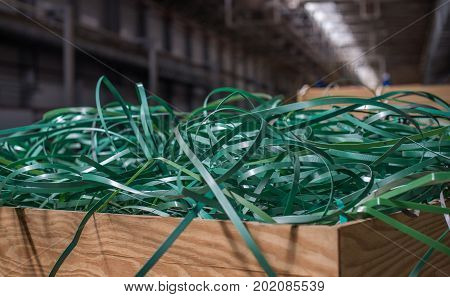 The Pile Of Waste Plastic Strip In Wooden Box.