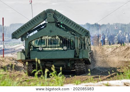 Tyumen, Russia - August 4, 2017: International Army Games. Engineering Formula contest. Highest military and engineering school ground. Speed driving of BAT track layer