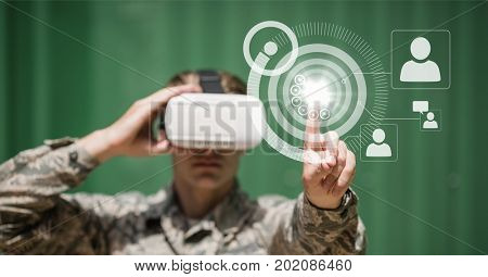Digital composite of Man in VR headset touching interface with flare