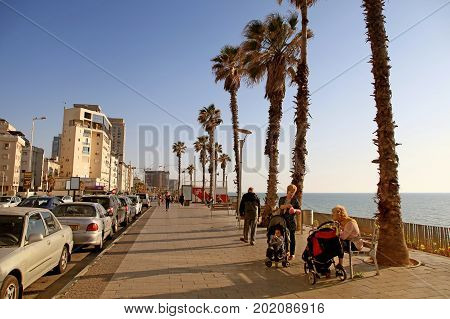 BAT YAM, ISRAEL - APRIL 4, 2016: Visitors in Bat Yam esplanade, Bat Yam, Israel. Bat Yam is a resort city located near Tel Aviv on Israels Mediterranean Sea coast.