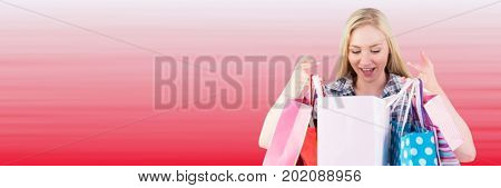 Digital composite of Shopper looking into bags against blurry red background