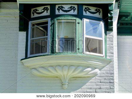 Nineteenth century brick house triple bay window