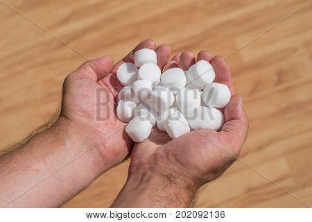 Salt pellets for the water softener. Selective focus.