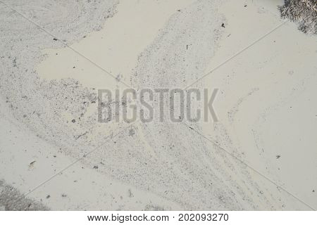 Stains And Debris On The Surface Of The Spilled White Liquid. Abstract Texture