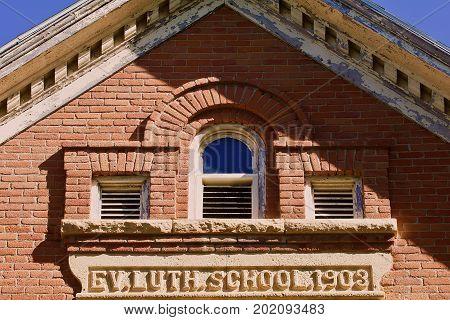 Early twentieth century building brick and limestone facade