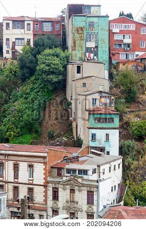 Row of buildings going up a steep hill in Valparaiso Chile