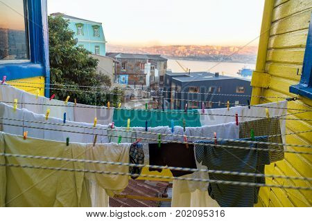 Laundry hanging out to dry with a view of Valparaiso Chile in the background