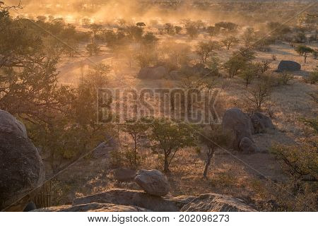 A sunset landscape with lots of dust at the Hoada Camp in the Kunene Region of Namibia