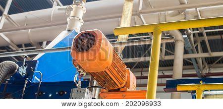 Orange electric motor. Selective focus. Industrial photos