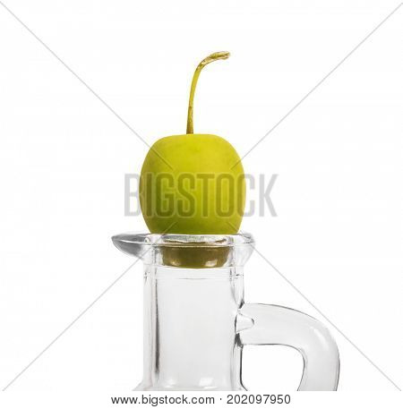 Green olive on a bottle for olive oil. Isolated on white background