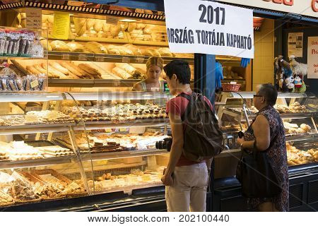 BUDAPEST, HUNGARY - 21 AUGUST 2017: The big central market of Budapest, a place of visiting of tourists for purchases of sausages of a paprika of souvenirs.