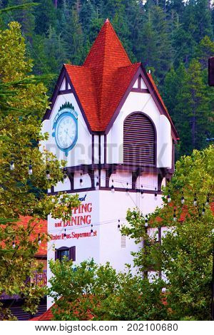 August 29, 2017 in Lake Arrowhead, CA:  Clock Tower Building surrounded by a lush pine forest and overlooking the Lake Arrowhead Village where people can shop and dine while surrounded by natural beauty taken in Lake Arrowhead, CA