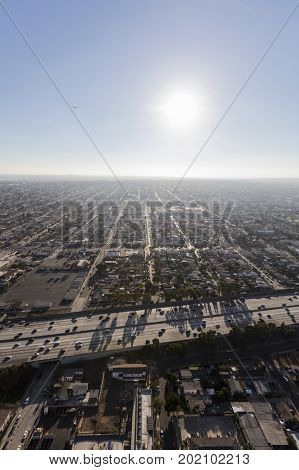 Vertical aerial of South Central Los Angeles and the Harbor 110 freeway.