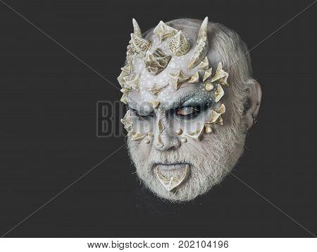 Man With Dragon Skin And Grey Beard
