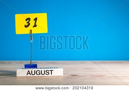 August 31th. Image of august 31 notice calendar on blue background. Last Summer day. Empty space for text. Day before september.