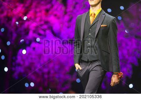 Sofia, Bulgaria - 23 March, 2017: A male model walks the runway in stylish modern business during a Fashion Show. Fashion catwalk event showing new collection of clothes.