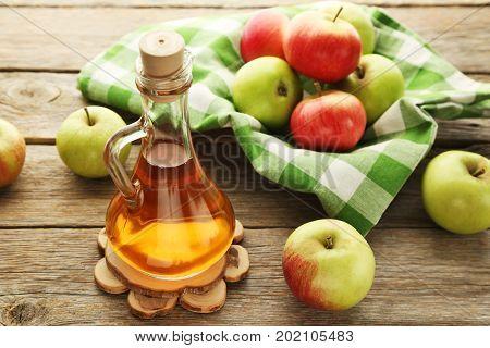 Apple Vinegar In Glass Bottle On Grey Wooden Table