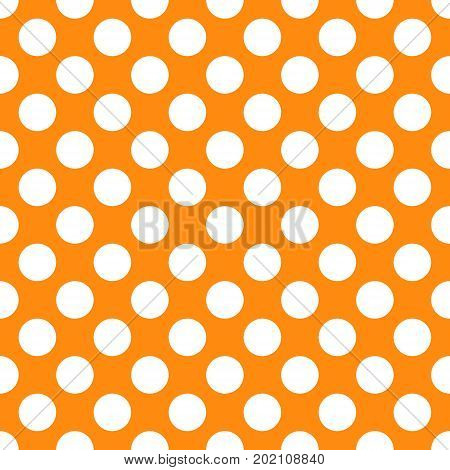 A seamless orange polka dot background paper pattern.
