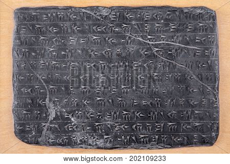Cuneiform script. Babylonian stone with cuneiform writing isolated on white with clipping path